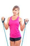 Beautiful young fitness trainer standing isolated Royalty Free Stock Image