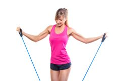 Beautiful young fitness trainer standing isolated Royalty Free Stock Photo