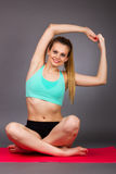 Beautiful young fitness woman doing exercises  on the floor Stock Photography