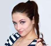 Beautiful young flirting woman holding hair Stock Photo