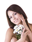 Beautiful young with flower. Massage. Stock Photo