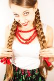 A beautiful young folk woman presents her long tresses Stock Images