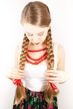 A beautiful young folk woman presents her long tresses Royalty Free Stock Image