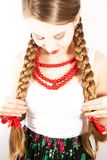 A beautiful young folk woman presents her long tresses Stock Photo