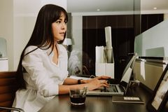 Beautiful Young Freelancer Woman Using Laptop Computer at home o Stock Images