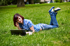 Beautiful young freelancer woman using laptop Stock Photography