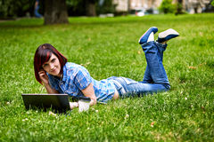 Beautiful young freelancer woman using laptop Stock Images