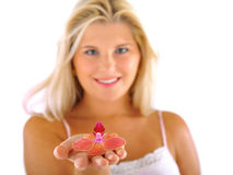 Beautiful young fresh female holding a flower Stock Photo