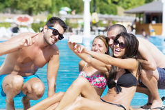Beautiful young friends having fun making selfie on the pool Royalty Free Stock Photos