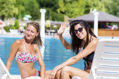 Beautiful young friends having fun on the pool Royalty Free Stock Images