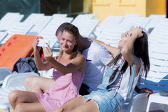 Beautiful young friends laughing and  making selfie on the pool Royalty Free Stock Images