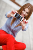 Beautiful young funky woman making selfie while sitting outdoors Royalty Free Stock Photo