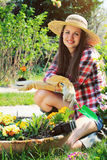 Beautiful young gardener smiles in a relax pose Stock Photography