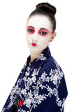 Beautiful young Geisha girl. Image showing pretty young geisha girl isolated against white Stock Photos