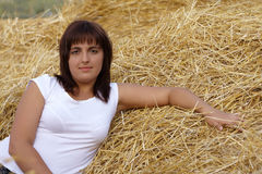 Beautiful young girl. On hayloft royalty free stock photography