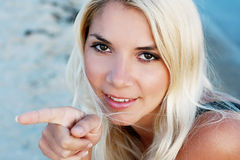 Beautiful young girl. Shows a finger on something Royalty Free Stock Image