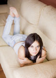 Beautiful young girl. Beautiful girl portrait sitting in the sofa of a living room Stock Photo