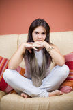 Beautiful young girl. Beautiful girl portrait sitting in the sofa of a living room Stock Images