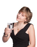 Beautiful young girl. Drinking water from a glass Royalty Free Stock Photos