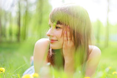 Beautiful young girl. Lying on grass stock photography