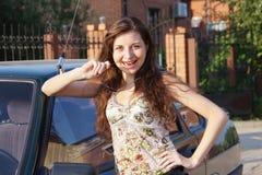 Beautiful young girl. Near a car Stock Photography