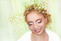A beautiful young girl. A beautiful young girl with make-up and a flower in her hair stock photos