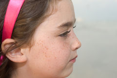 Beautiful young girl. At the beach in profile Royalty Free Stock Images