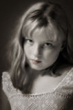 Beautiful Young Girl. Lovely preteen girl showing budding maturity in antique lace, sepia with color in eyes and lips Stock Image