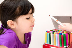 Beautiful Young Girl Admiring Her Friends Markers Royalty Free Stock Photos