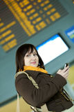 Beautiful young girl in airport Royalty Free Stock Photography
