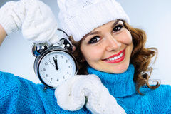 Beautiful young girl with alarm clock Stock Photo