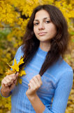 Beautiful young girl is by an autumn day Stock Photography