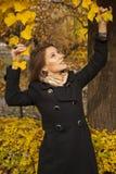 Beautiful young girl in an autumn park Stock Photos