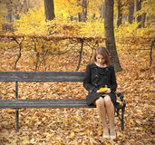 Beautiful young girl in an autumn park Stock Image