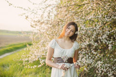 Beautiful young girl on background apple-tree Stock Photography