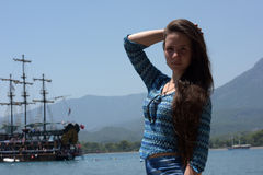 Beautiful young girl on the background of sailing Stock Images
