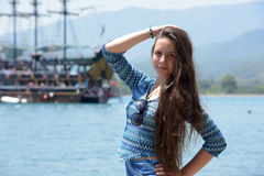 Beautiful young girl on the background of sailing Stock Photography