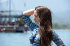 Beautiful young girl on the background of sailing Royalty Free Stock Image