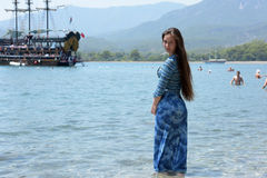 Beautiful young girl on the background of sailing Royalty Free Stock Photography