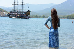 Beautiful young girl on the background of sailing Stock Image