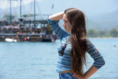 Beautiful young girl on the background of sailing Royalty Free Stock Photos