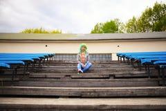 Beautiful young girl with bag posing football stadium Royalty Free Stock Photos
