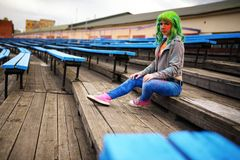 Beautiful young girl with bag posing football stadium Stock Photography