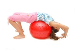Beautiful young girl with ball exercising Royalty Free Stock Image