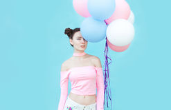 Beautiful and young girl with balloons smiling. Bright portrait of beautiful girl with balloons Royalty Free Stock Image
