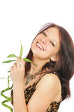 Beautiful young girl with a bamboo in hands Royalty Free Stock Images