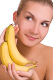 Beautiful young girl with banana Stock Image