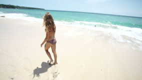 Beautiful young girl on the beach is happy stock video footage