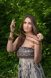 The beautiful young girl with a beads in hands Stock Image