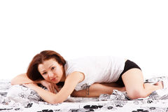 Beautiful young girl in bed Stock Photos